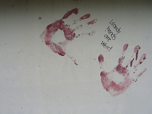 Flagler College bloody hands grafitti picture