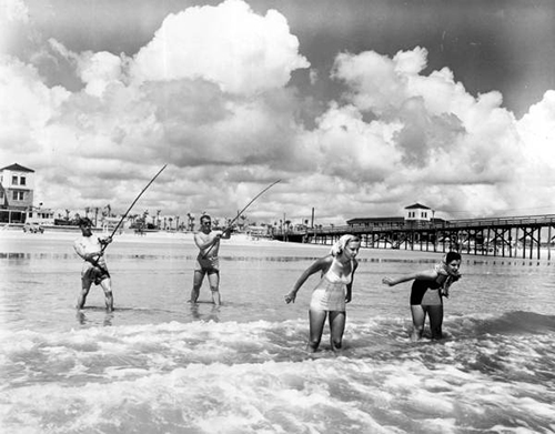 Photo of historic couples fishing at pier