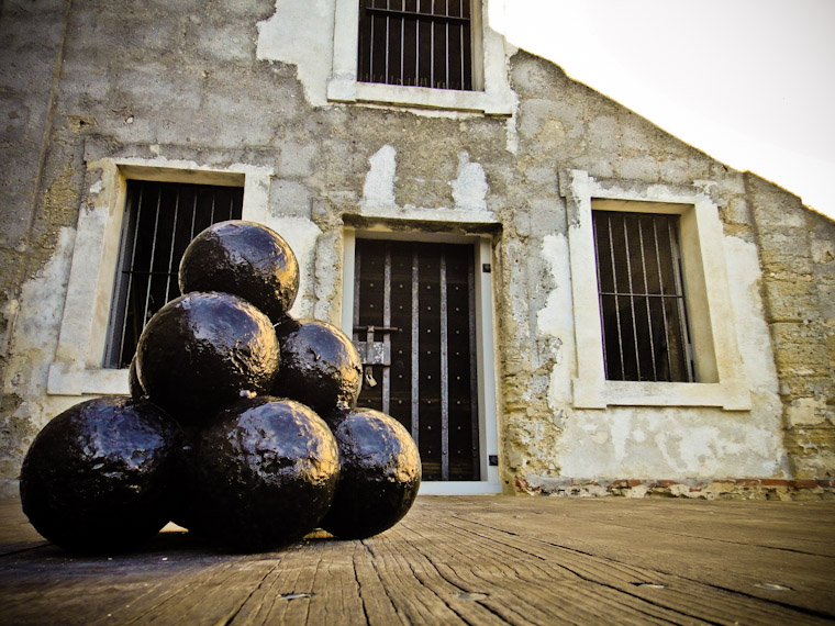 Photo of stacked cannonballs and windows in Saint Augustine Florida