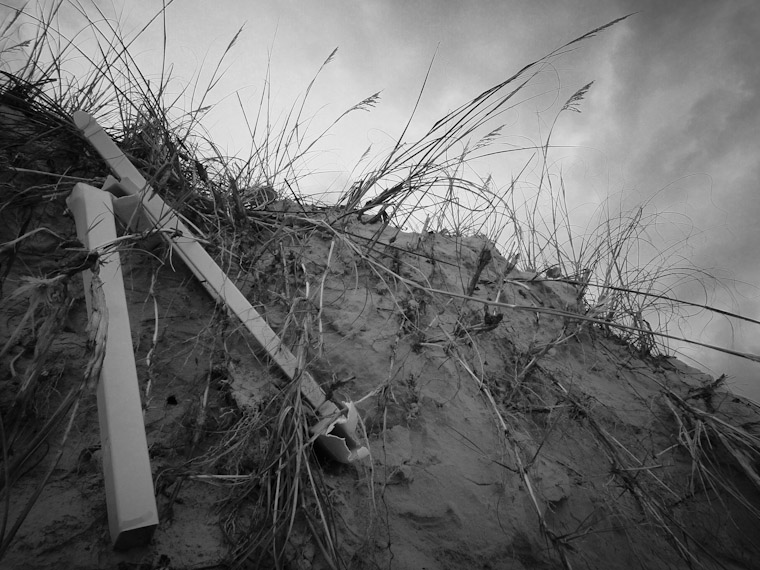 Photo of dune fence post erosion in Saint Augustine Beach