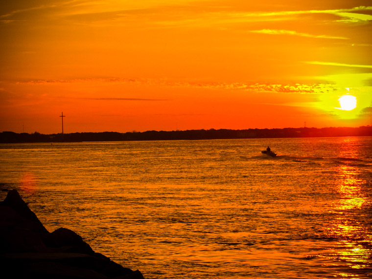Boat returning at sunset