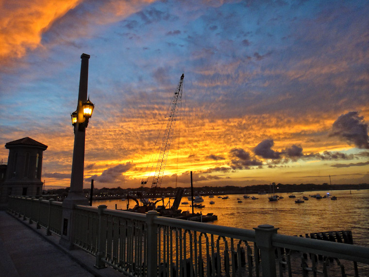 Sunset behind crane barge removing temporary bridge of lions
