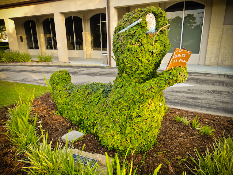 Carved shrub sculpture at library