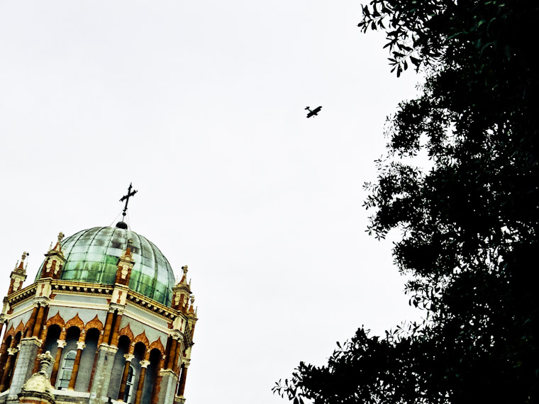 Biplane flying over memorial presbyterian dome