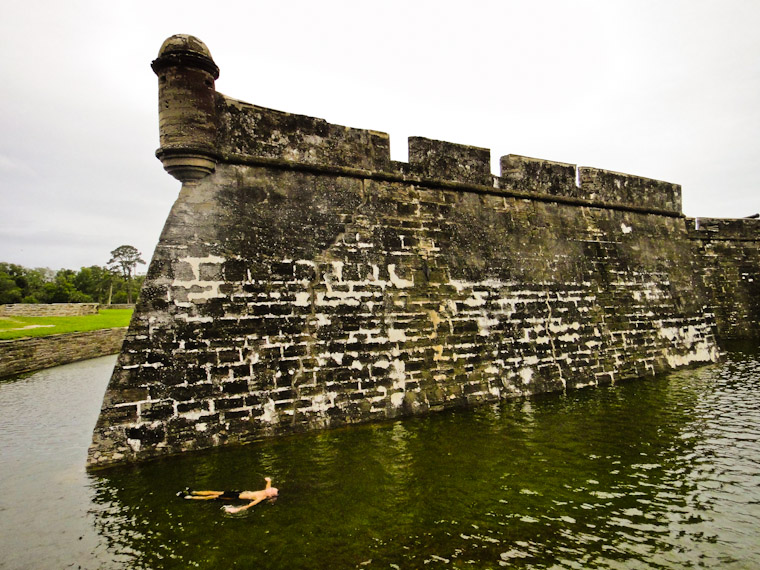 Person doing back float in Castillo de san marcos moat