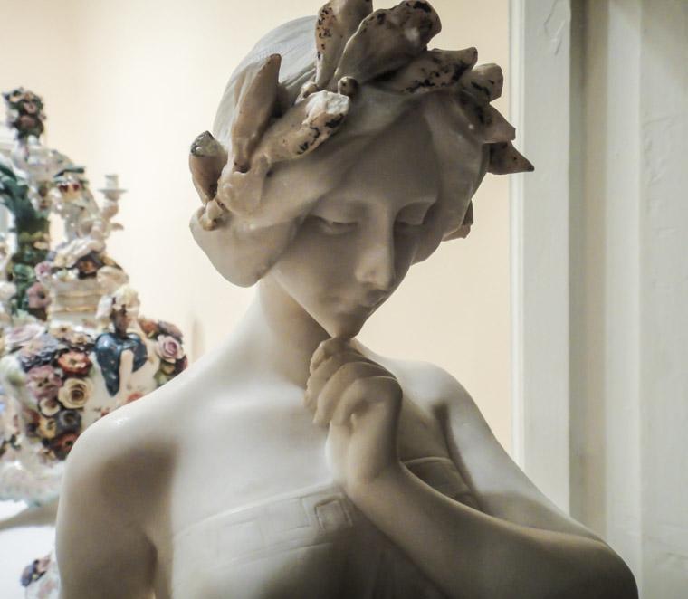 Contemplating statue at Lightner Museum