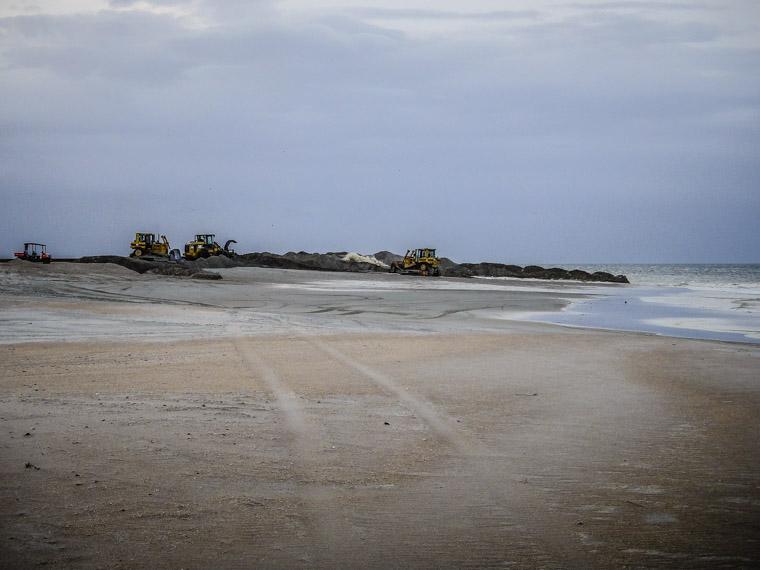 Beach dredge by pier