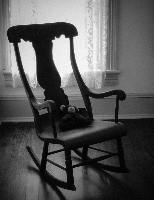 Teddy bear and rocking chair at Dow Museum of historic houses