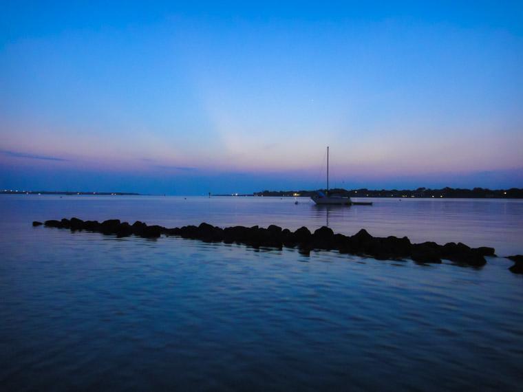 Intracoastal sunrise sailbot boat