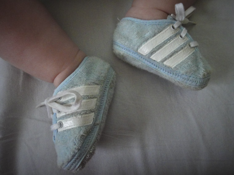 Son wearing father's adidas shoes