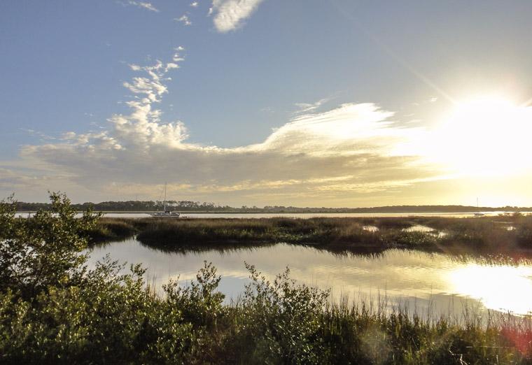 Intracoastal sunrise sailboats marsh