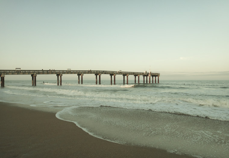Beach pier sunset waves