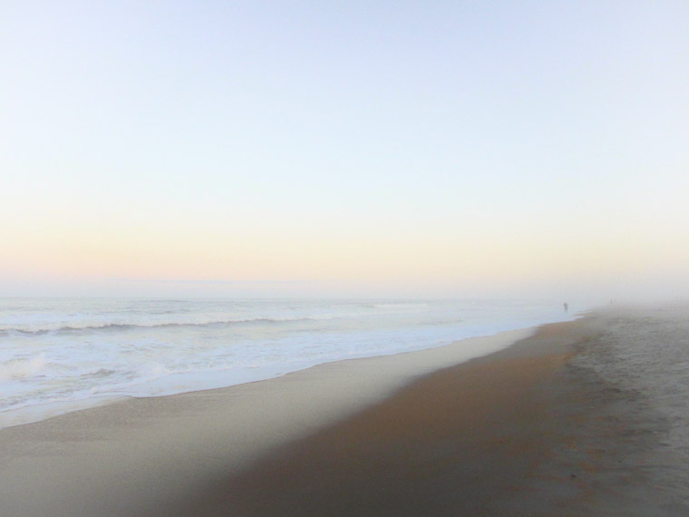 Beach misty fog waves sunset