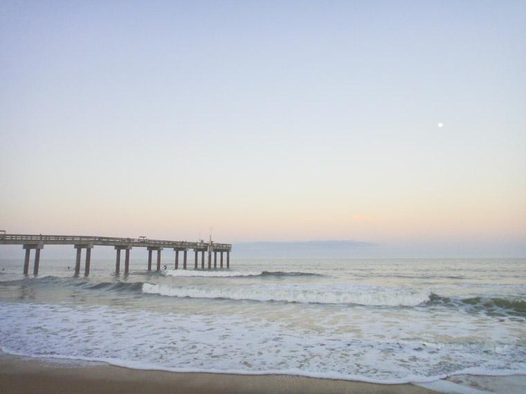 Beach pier surfing waves sunset