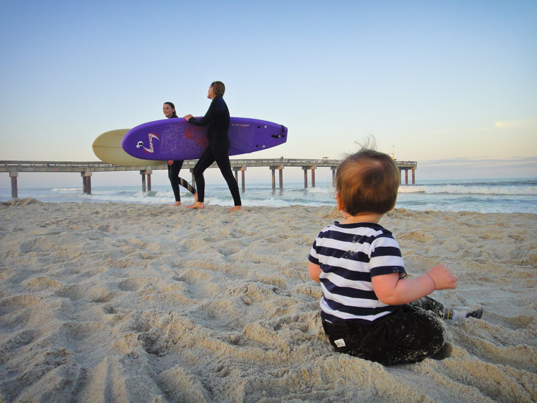 Pier beach surfers sunset