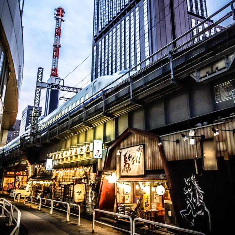 Tokyo Japan bullet train over restaurant
