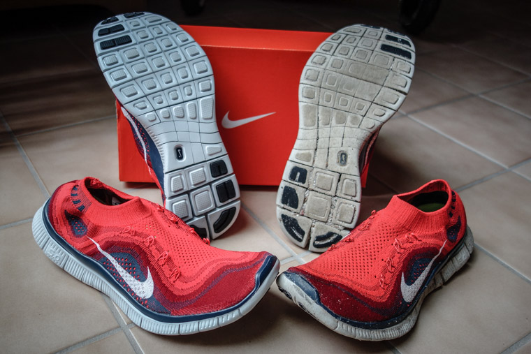 New and worn Nike Flyknit Free running shoes worn