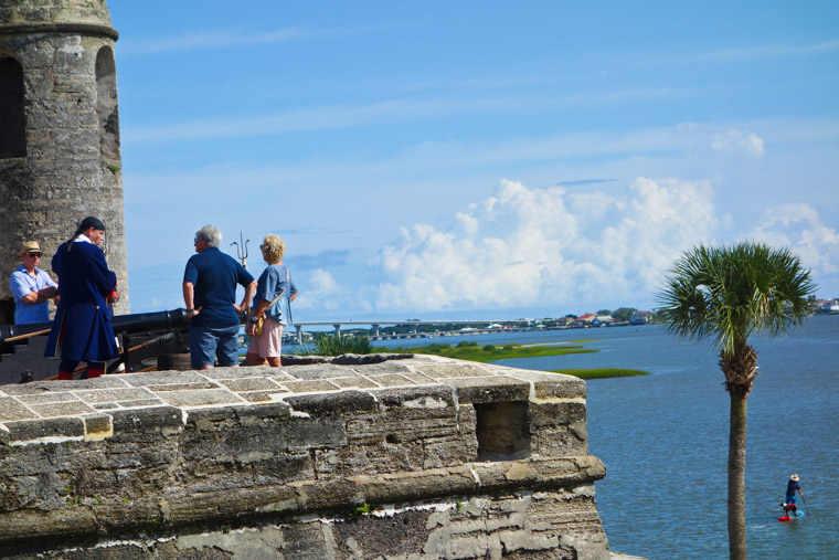 Stand up paddleboarding by fort castillo de san marcos cannon