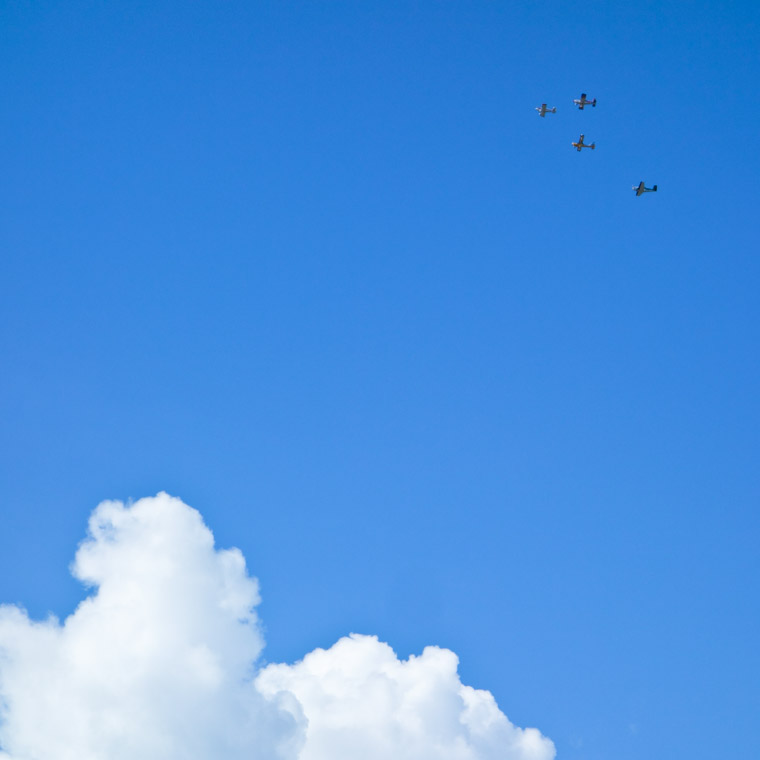 Airplanes in formation with blue sky and clouds