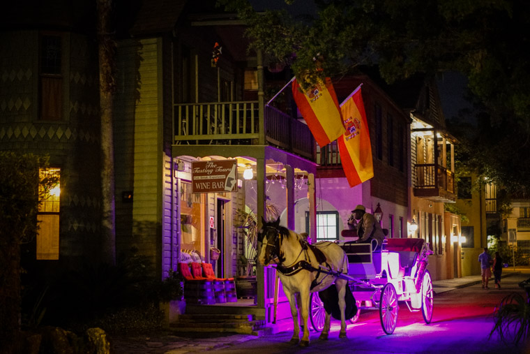 Horse carriage at wine bar with neon lights