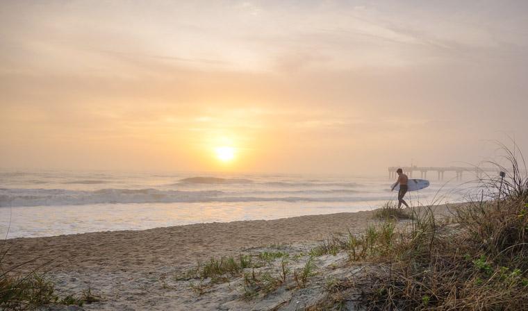 Sunrise surf session at pier
