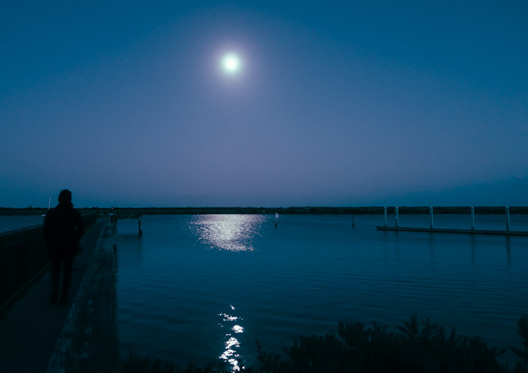 Moonrise over intracoastal dock and boat ramp
