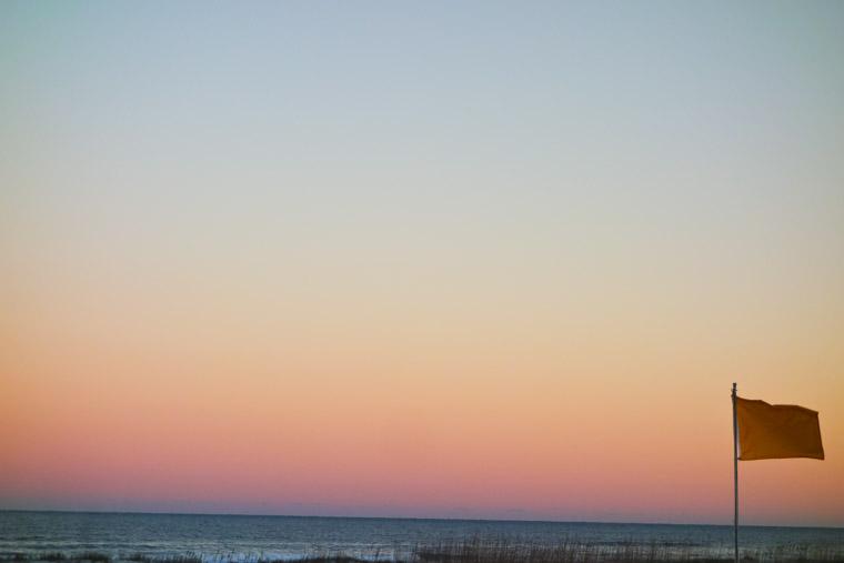 Beach sunset flag